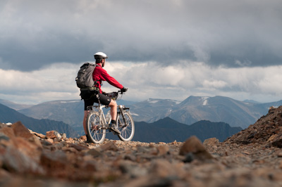 As a beam of light pierces the clouds, Dan stops to soak up the views.