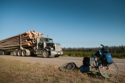 A timber truck thunders past as I fix a puncture - my first in 4500kms.