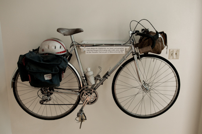 Variois touring bikes have found their retirement on the office walls, including one of legendary Kiwi traveller XXX.