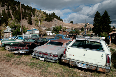 More rusty, junked cars than people, I think.,