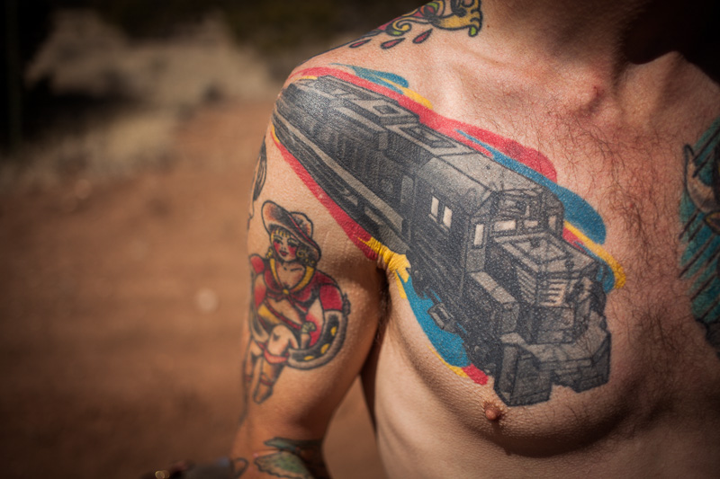 It was tops off weather, at least for Jeremy - he of the short shorts in winter... This particular tattoo celebrates his love of train hopping.