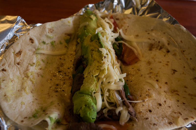 A carne asada, onion and avocado burrito filled even this famished cyclist...