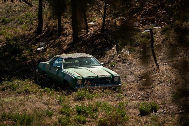 Past more derelict cars...